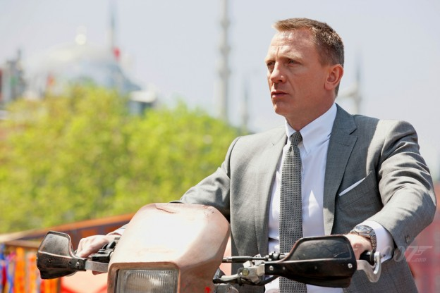 Daniel Craig as Bond on bike skyfall photo