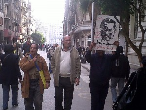 Men with a sign depicting Hosni Mubarak as a monster. January 2011 Photo/Mona via wikimedia commons