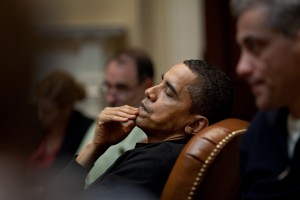 President Obama reflects during an economic meeting with advisors in the Roosevelt Room. He is seated between Senior Advisor David Axelrod and Chief of Staff Rahm Emanuel , right. 3/15/09. Official White House Photo by Pete Souza