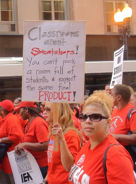 "Striking Chicago teachers; one sign reads: ""Classrooms aren't sweatshops! You can't pack a room full of students & expect the same final product!"" September 10, 2012 photo/firedoglakedotcom"