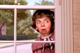 Gladys Kravitz nosy neighbor peeking window