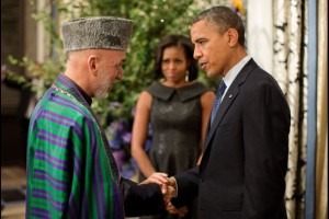 President Barack Obama talks with President Hamid Karzai of Afghanistan before the United Nations General Assembly reception at the Waldorf Astoria Hotel in New York, N.Y., Sept. 24, 2012. First Lady Michelle Obama is pictured in the background. (Official White House Photo by Pete Souza)