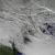 This image from the NOAA GOES-13 satellite shows the Christmas 2012 storm  system on December 27, 2012 at 1845z. The center of low pressure can be seen over New England, along with gravity waves in the cloud formations over Pennsylvania, Maryland, and Virginia.  NOAA photo