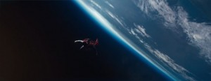 Henry Cavill as Superman flying over earth