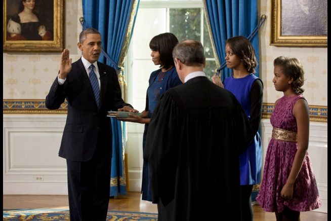 Supreme Court Chief Justice John Roberts administers the oath of office to President Barack Obama during the official swearing-in ceremony in the Blue Room of the White House on Inauguration Day, Sunday, Jan. 20, 2013. First Lady Michelle Obama, holding the Robinson family Bible, along with daughters Malia and Sasha, stand with the President. (Official White House Photo by Lawrence Jackson)