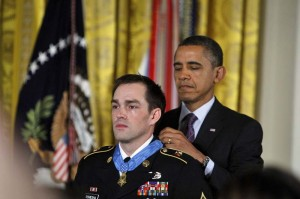 Former Army Staff Sgt. Clinton Romesha receives the Medal of Honor from President Obama at a White House ceremony on Feb. 11.  Mike Morones / Military Times