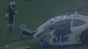Kyle Larson next to the remains of his car after the Daytona 500 crash screenshot NASCAR.com video