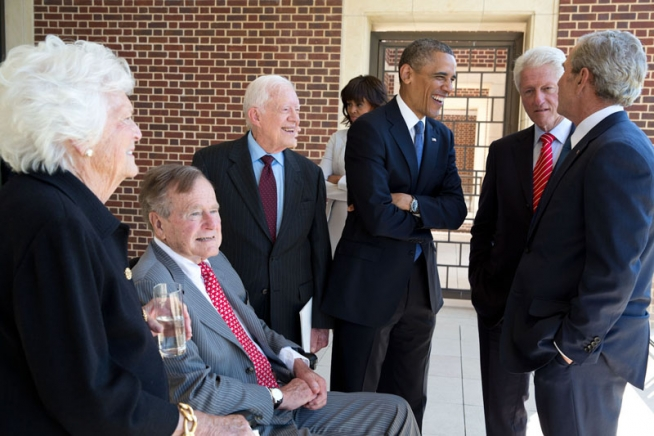 President Barack Obama talks with former Presidents George H.W. Bush, Jimmy Carter, Bill Clinton, George W. Bush, and former First Lady Barbara Bush at the opening of the George W. Bush Presidential Library and Museum in Dallas, Texas, April 25, 2013. First Lady Michelle Obama talks with former First Lady Hillary Rodham Clinton in the background. (Official White House Photo by Pete Souza)