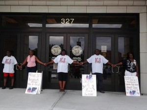 Kendrick Johnson's parents and supporters were arrested after blocking the federal building on Thursday photo Facebook