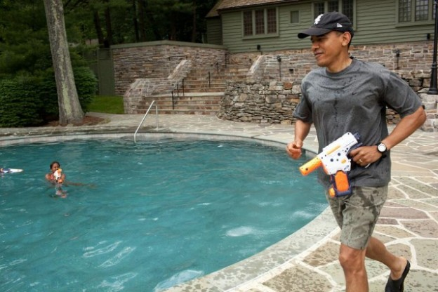 President Obama enjoys Father's Day by playing water guns with his daughters, no injuries were reported