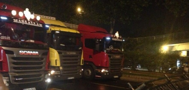 protesters use semi trucks to create a blockade of their own