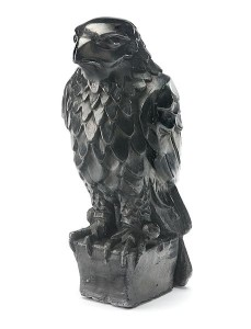 """A plaster Maltese Falcon prop used in """"The Maltese Falcon"""" (1941). The model for the prop (known as """"Falcon prop #6"""") was sculpted by artist Fred Sexton for his friend, director John Huston. Sexton inscribed his initials on the plaster prop. photo by Hank Risan via wikimedia commons"""