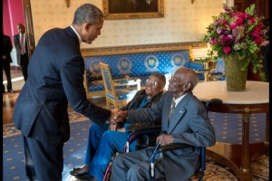 President Barack Obama greets Richard Overton, with Earlene Love-Karo, in the Blue Room of the White House, Nov. 11, 2013. Mr. Overton,107 years old and the oldest living World War II veteran, attended the Veteran's Day Breakfast at the White House. (Official White House Photo by Lawrence Jackson)