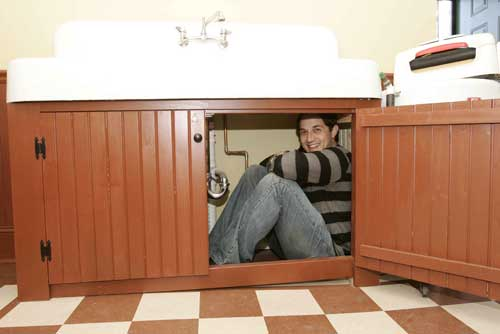 Ian Petrella, reliving his days as Randy under the sink - A Christmas Story House photo