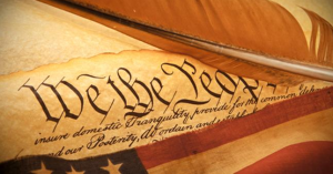 The Founding Parents logo Constitution flag quill