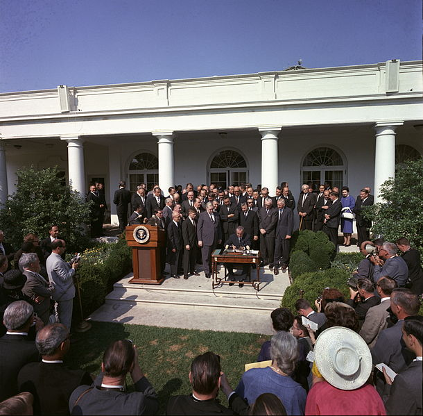 The day President Johnson signed the Economic Opportunity Act of 1964