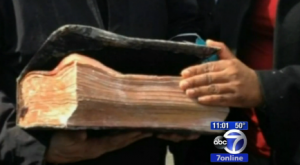 screenshot of video coverage of gas explosion, Bible that survived