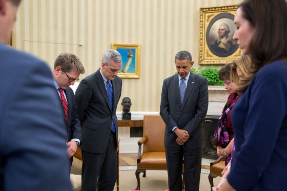 President Barack Obama observes a moment of silence during his meeting with senior advisors in the Oval Office at 2:49 P.M. to mark the one-year anniversary of the Boston Marathon bombings, April 15, 2014. Pictured from left, are Senior Advisor Dan Pfeiffer, Press Secretary Jay Carney, Chief of Staff Denis McDonough, Senior Advisor Valerie Jarrett, Communications Director Jennifer Palmieri, and Katie Beirne Fallon, Director of Legislative Affairs. (Official White House Photo by Pete Souza)  .