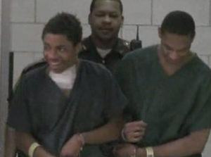 Murder suspect Simeon Adams was all laughts as he entered court on Thursday  photo is a screenshot of the coverage by WXIN
