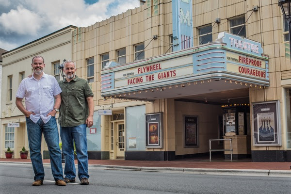 Alex and Stephen Kendrick pose outside The Gem Theater in historic downtown Kannapolis, N.C., after filming car scenes for their new movie. (Courtesy of AFFIRM Films/Provident Films, Photo credit: Kevin Peeples)
