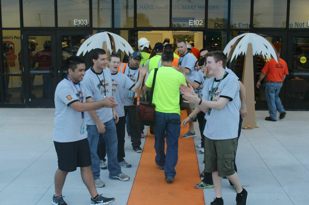 Newly hired Amazon employees are cheered on by co-workers and managers as they walk the orange carpet into Amazon's Lakeland, Fla., fulfillment center for their first day of work. The company expects to continue to hire and grow its full-time workforce in Lakeland. In addition to competitive wages and benefits, Amazon also offers full-time employees innovative programs like Career Choice, where the company will pre-pay up to 95 percent of tuition for courses related to in-demand fields, regardless of whether the skills are relevant to a career at Amazon.