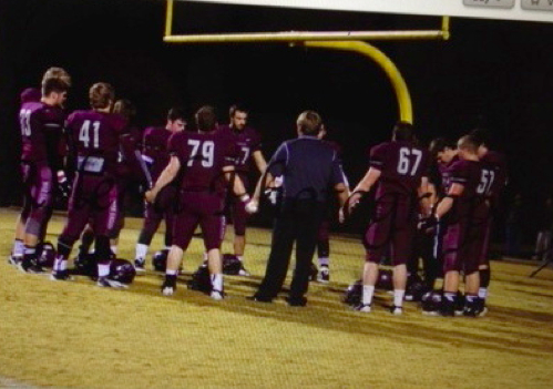 A Florida school district caves to a Freedom From Religion threats  photo Georgia high school team praying before a game/ American Humanist Association