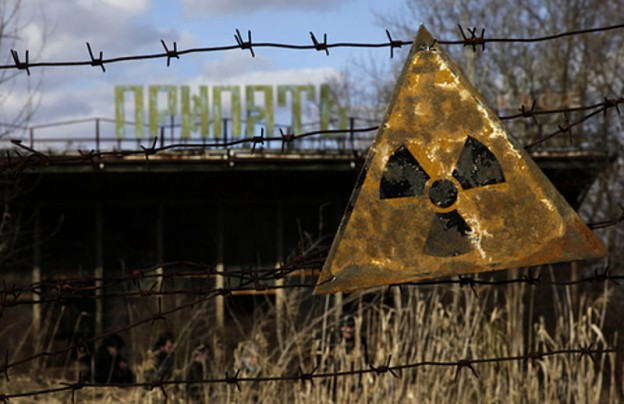 A radioactive sign hangs on barbed wire outside a café in Pripyat. photo VOA Photo / D. Markosian