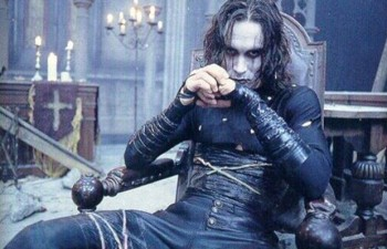 Brandon Lee The Crow in chair photo