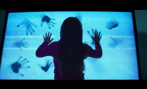 Poltergeist 2015 girl at Tv hands inside