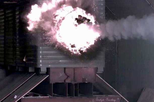 In this Jan. 28, 2007 photo, a test slug impacts the target after being fired from the Electromagnetic Railgun laboratory launcher, or railgun at the Naval Surface Warfare Center, in Dahlgren, Va.  (U.S. Navy, John F. Williams)