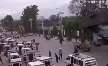 Nepal earthquake: The small building on the right collapsing to the street was captured on CCTV