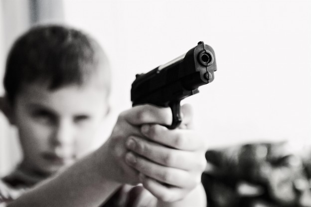 kid pointing handgun photo/ Michael Jarmoluk via pixabay.com