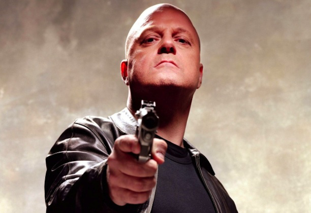 Michael Chiklis with a handgun