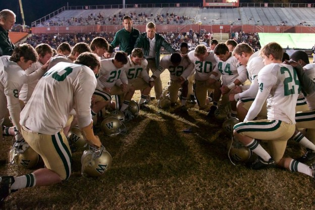 Woodlawn football team praying