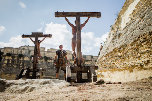 A body is removed from the cross by the guard (Andy Gathergood). Calvary. Image courtesy of Rosie Collins
