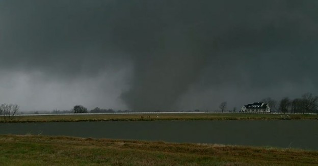 A tornado touching down in Alabama on Tuesday photo/ screenshot of WBRC video coverage