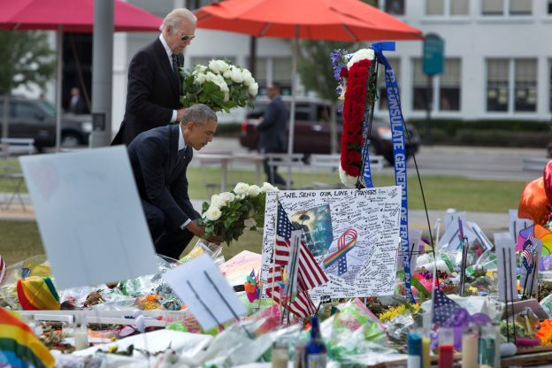 President Barack Obama and Vice President Joe Biden place bouquets of flowers at a memorial for the victims of the terrorist attack at the Pulse nightclub, at the Dr. Phillips Center for the Performing Arts in Orlando, Fla., June 16, 2016. (Official White House Photo by David Lienemann)