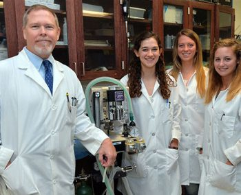 Photo: Dr. Elmer Price is shown with researchers, from left, Lydia Hager, Arrin Carter and Amanda Clark. Photo by Rick Haye/Marshall University.