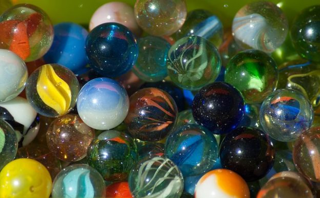 """Missing Marbles"" are link ""Missing Links""  photo/ jacqueline macou via pixabay"