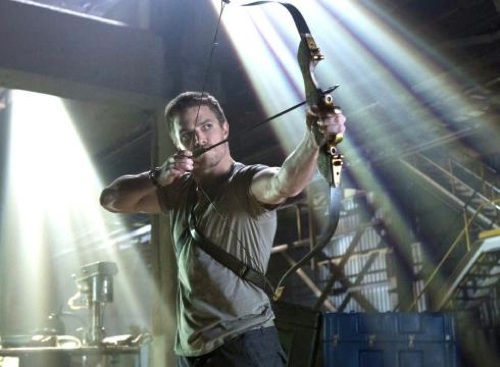 Stephen-Amell-as-Arrow-CW-TV-show-photo with bow and arrow