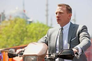 Daniel Craig as Bond on bike skyfall photo