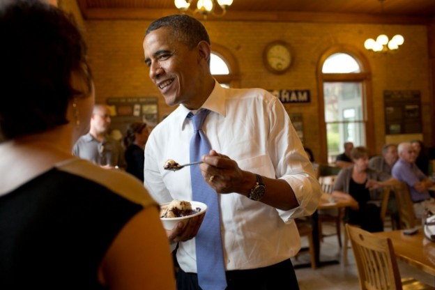 President Barack Obama eats a hot fudge sundae as he talks with patrons at the UNH Dairy Bar on the University of New Hampshire campus in Durham, N.H., June 25, 2012. (Official White House Photo by Pete Souza)