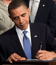 signing Obamacare into law photo
