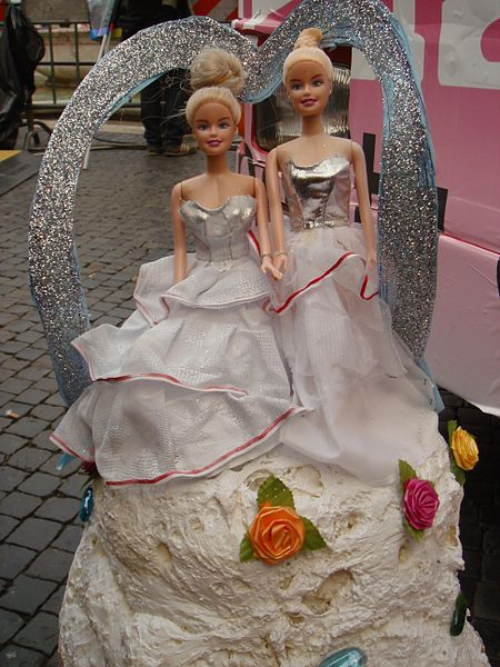 """Lesbian"" wedding mock-cake at the Roma Gay Pride in 2008. Picture by Stefano Bolognini via wikimedia commons."