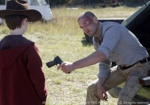 """Jon Bernthal  from """"The Walking Dead""""  season 2 photo Shane giving Carl a gun photo/AMC"""