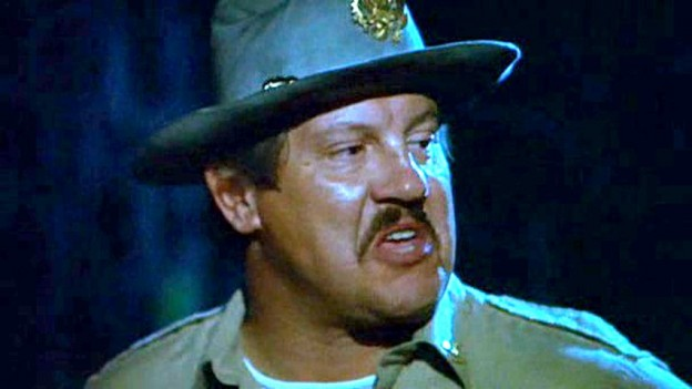 https://www.theglobaldispatch.com/wp-content/uploads/2012/10/Alex-Karras-as-sheriff-Wallace-in-Porkys-624x351.jpg