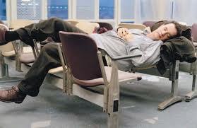Tom Hanks in The Terminal by Steven Spielberg sleeping in airport