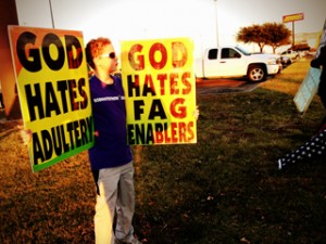 Little boy, Noah, protesting with Westboro Baptist Church in Texas photo Westboro website