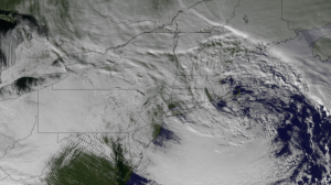 After picking up a tremendous amount of moisture from the Gulf of Mexico, the Christmas 2012 storm has moved across the eastern U.S. dumping rain and snow, causing major air traffic disruptions, and traffic jams across the interstates. This image from the NOAA GOES-13 satellite shows the system on December 27, 2012 at 1845z. The center of low pressure can be seen over New England, along with gravity waves in the cloud formations over Pennsylvania, Maryland, and Virginia.  NOAA photo