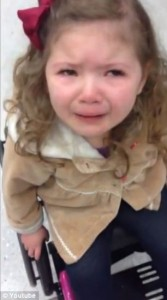 A child in wheelchair crying as TSA delayed her flight to Disney  screenshot of video coverage of story